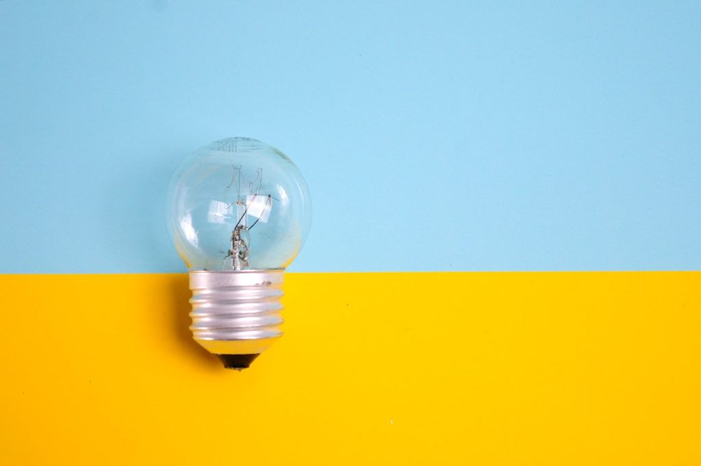 a light bulb on a blue and yellow background